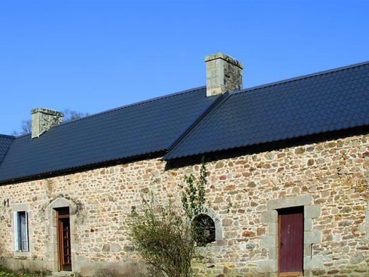 Geïsoleerde dakplaten met dakpanprofiel - © Bouwpunt Deckers
